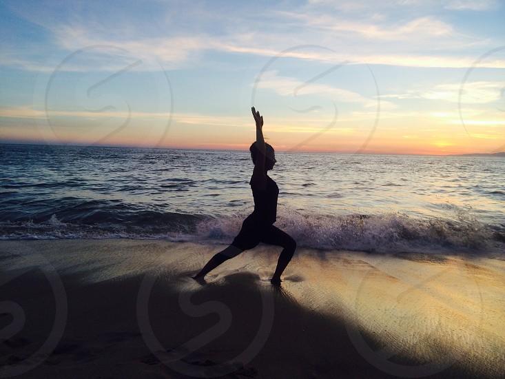 Beach yoga at the evening photo