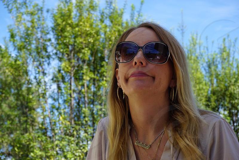 woman in white open neckline shirt photo