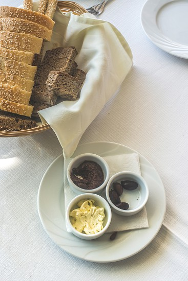 Close up table in greek restaurant. Olives and bread. Greece Athens Piraeus photo