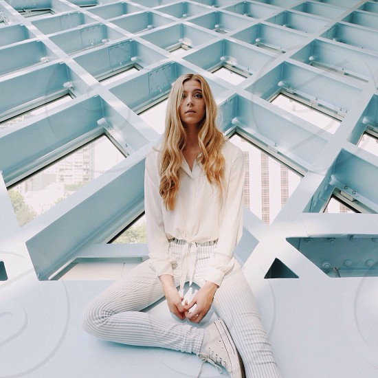 woman in white sheer dress shirt sitting photo