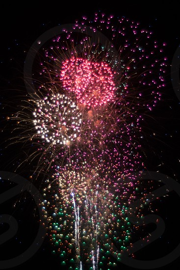 pink and white fireworks display photo
