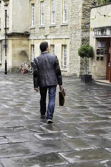 Business man walking to meeting in city  photo