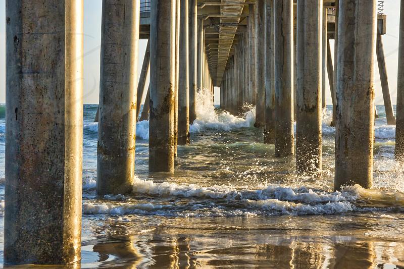 Water reflections under an ocean pier. photo