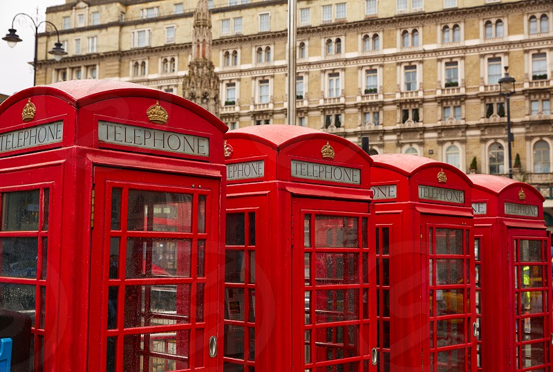 London old red Telephone boxes in a row at England photo