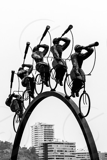 Bicycle rider statue framing buildings in Santiago Chile. photo