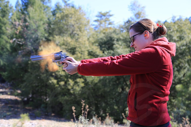 Woman Shooting .44 Magnum Revolver Handgun Gun Muzzle Flash Bullet Firearm Weapon photo