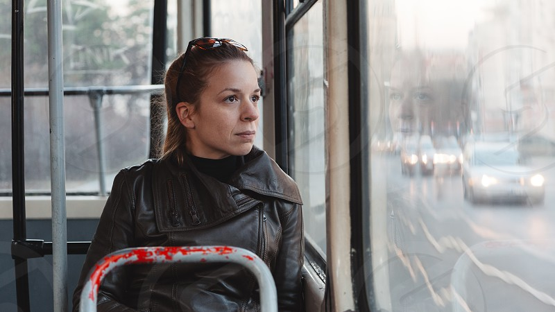Woman riding in a bus photo