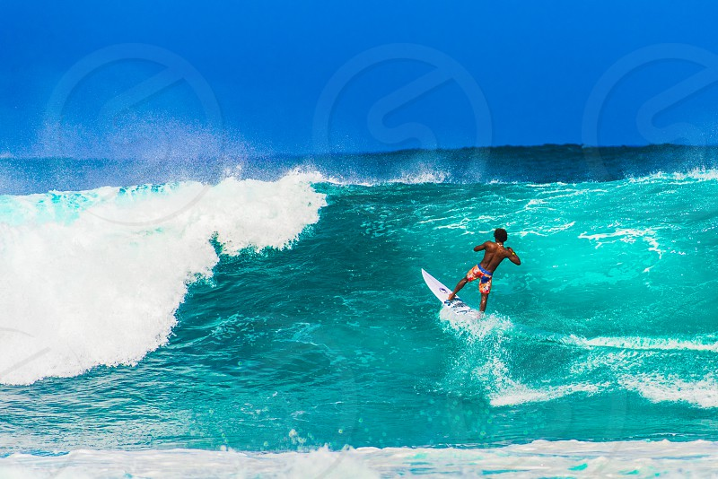 Surfer catching a big wave along North Shore Oahu Hawaii United States. photo