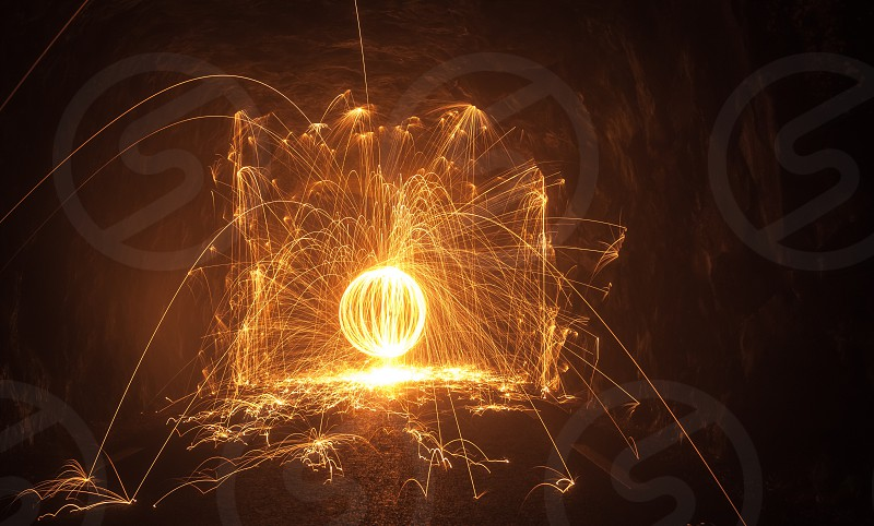 Spinning steel wool sparklesfire circle fireworks photo