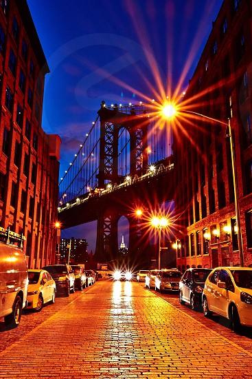 View of Empire State Building thru Manhattan Bridge in Brooklyn photo