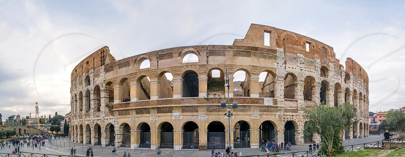 The Colosseum or Coliseum also known as the Flavian Amphitheatre is an oval amphitheatre in the centre of the city of Rome Italy. Built of concrete and sand it is the largest amphitheatre ever built photo