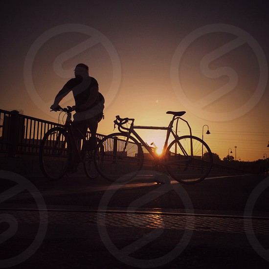 man on bicycle photo