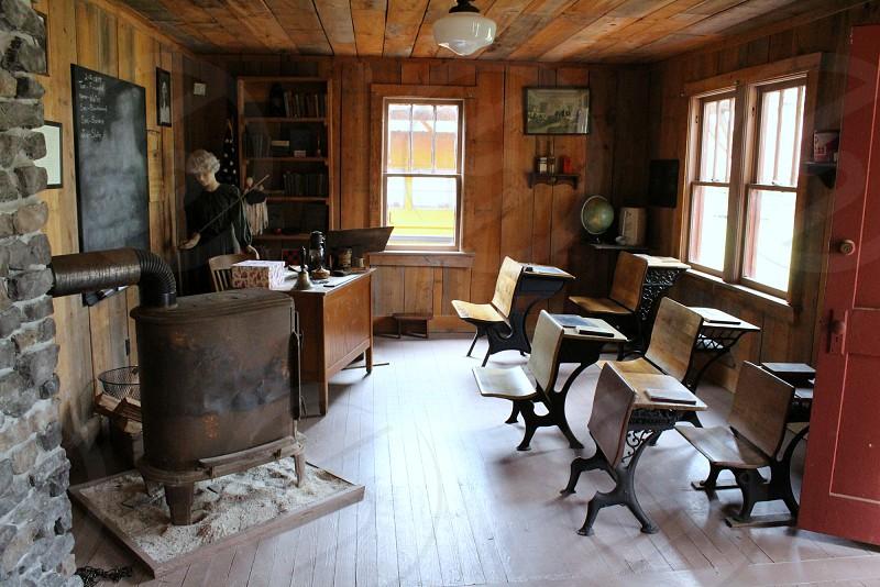 1880s schoolhouse interior with desks photo