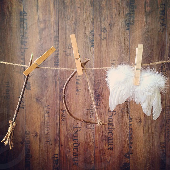 Stuff of cute cupidon bow and arrow love wings angel  photo
