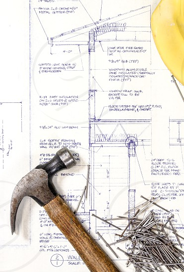 Hard hat hat hammer nails blueprint plans drawing planning construction future project property proposal  photo