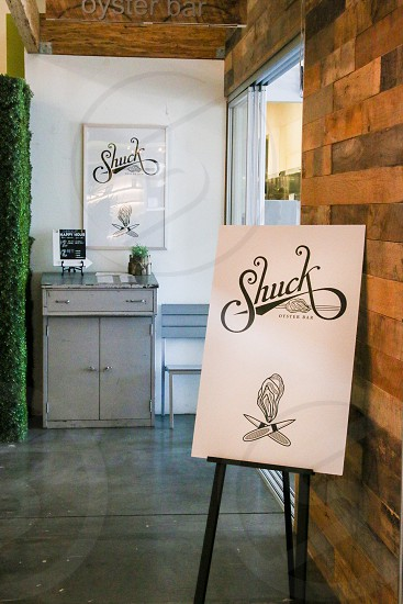 Shuck Oyster Bar Entrance and sign photo