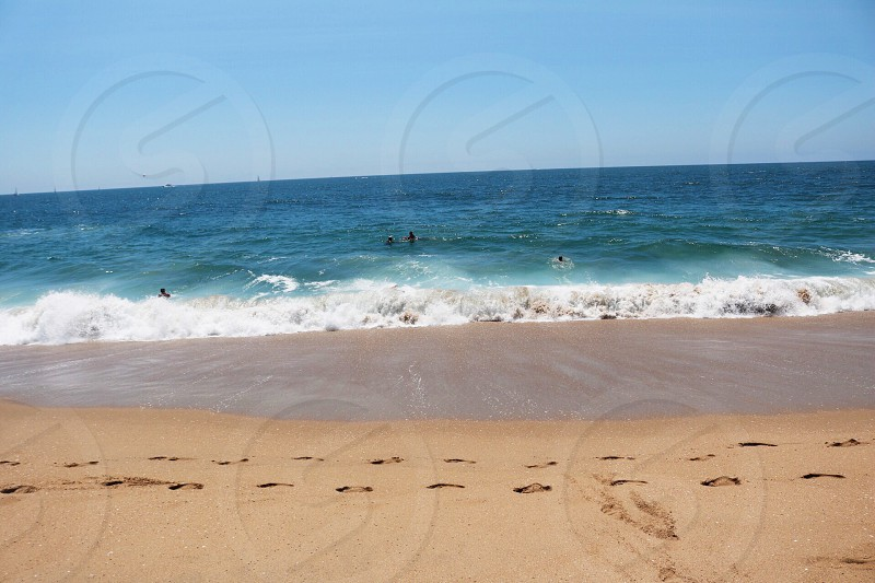 brown sand with footsteps at daytime photo