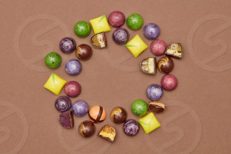 frame of chocolates on a brown background. photo