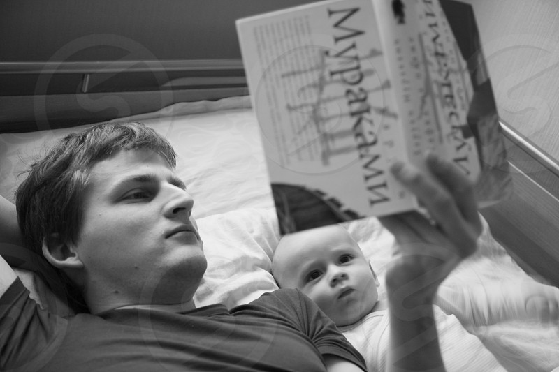 Father and son reading a book photo