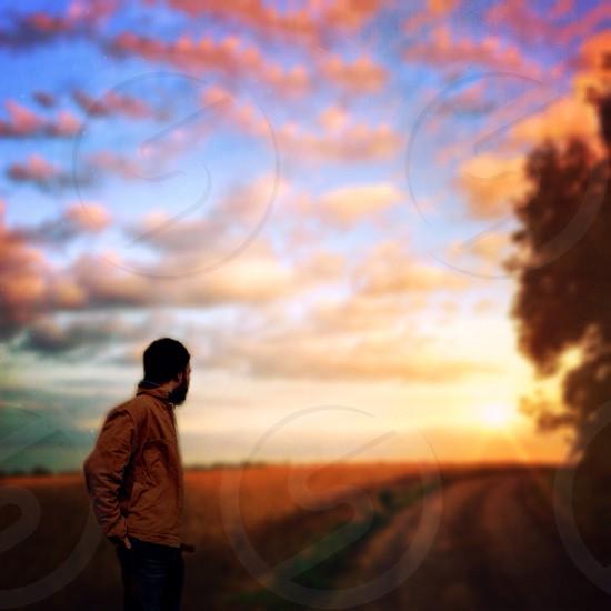 Farmer looking across his land photo