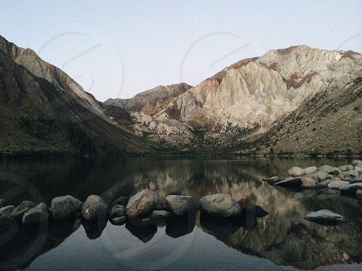 brown mountain and lake photo