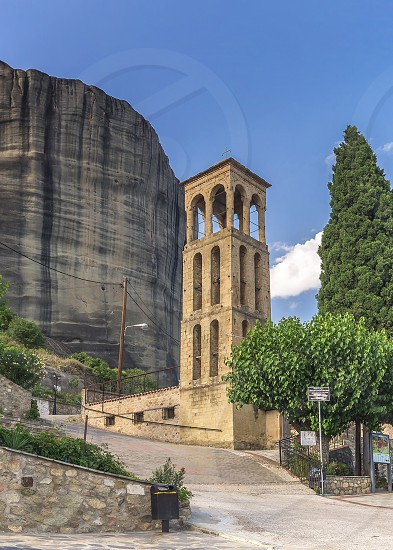 Panoramic view of the Assumption of Virgin Mary byzantine church in Meteora Kalambaka town in Greece on a sunny summer day photo