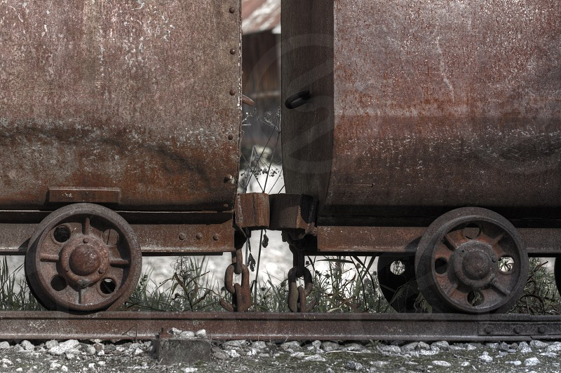 Brown Train Wheels on Railroad Track photo