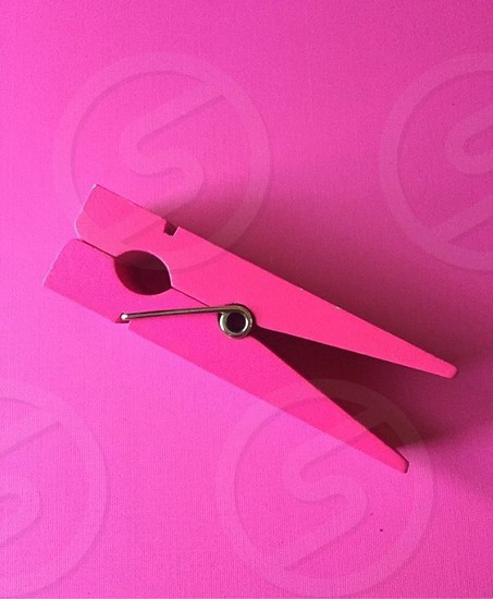 Monochromatic pink paper clip organization minimalism background design photo