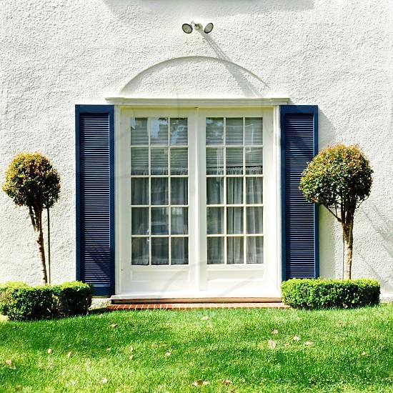 Window shutters bushes lawn photo