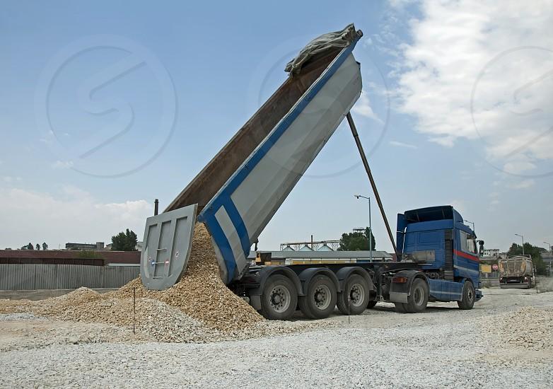 Blue Truck unload rocks photo