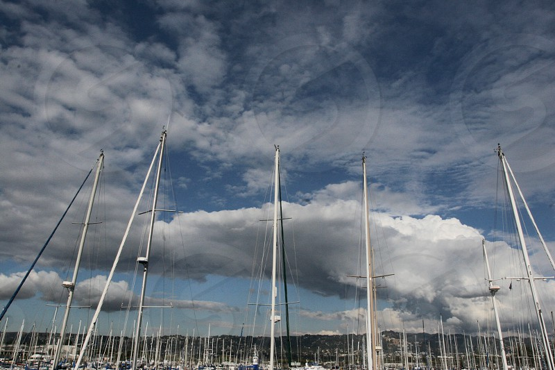 Boat masts at the marina with dramatic clouds photo