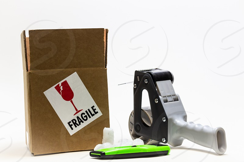 Box package tape ship fragile packaging cardboard knife supplies  photo