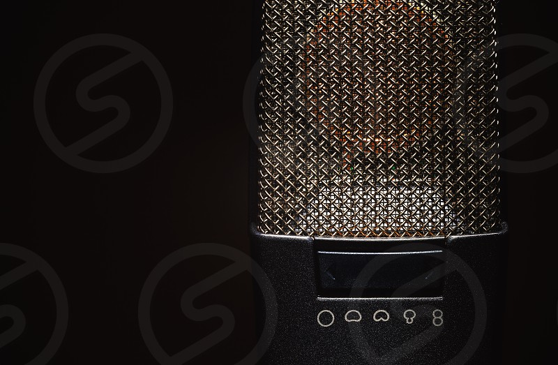 Closeup view on modern condenser microphone membrane and pattern details.  photo