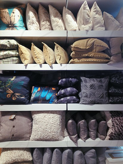 pillow display on five shelves photo