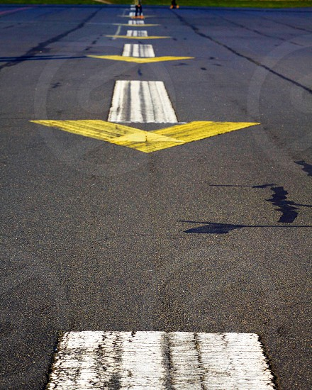 Arrows repeating Berlin templehofer Feld park airport Tarmac white yellow symmetry road outdoors recreation   photo