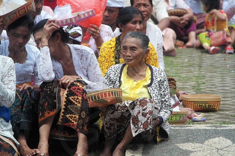 balinese prayers in the temple photo