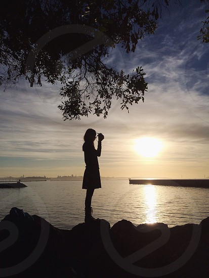 woman at the seaside at sunset photo