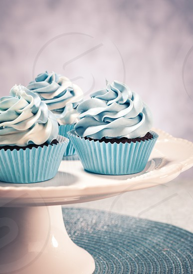Blue Cupcakes on a cake plate. Vintage style. photo