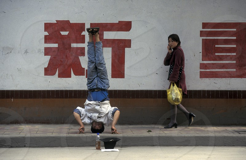 a men ask for money in the city of Chongqing in the province of Sichuan in china in east asia.  photo
