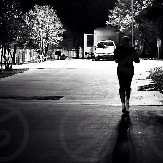 person's silhouette jogging grayscale photography photo