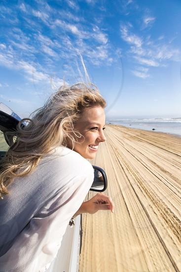 Family road trip fun beach car blonde girl photo