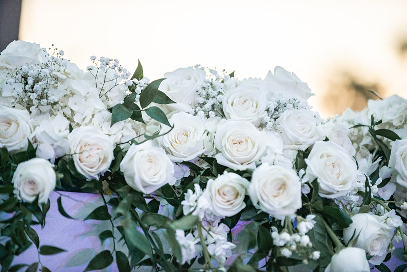 White roses floral bouquet on white table  photo