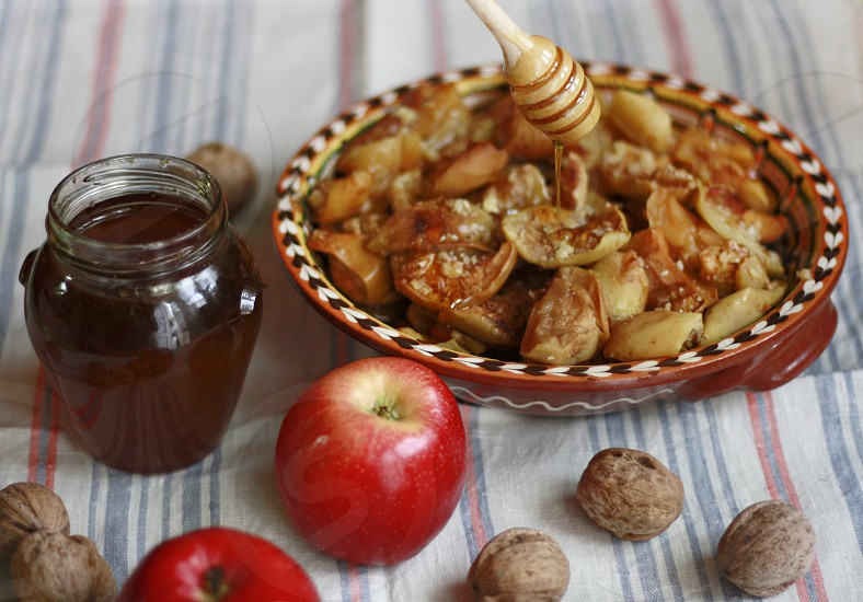 Baked apples and honey traditional food in Bulgaria photo