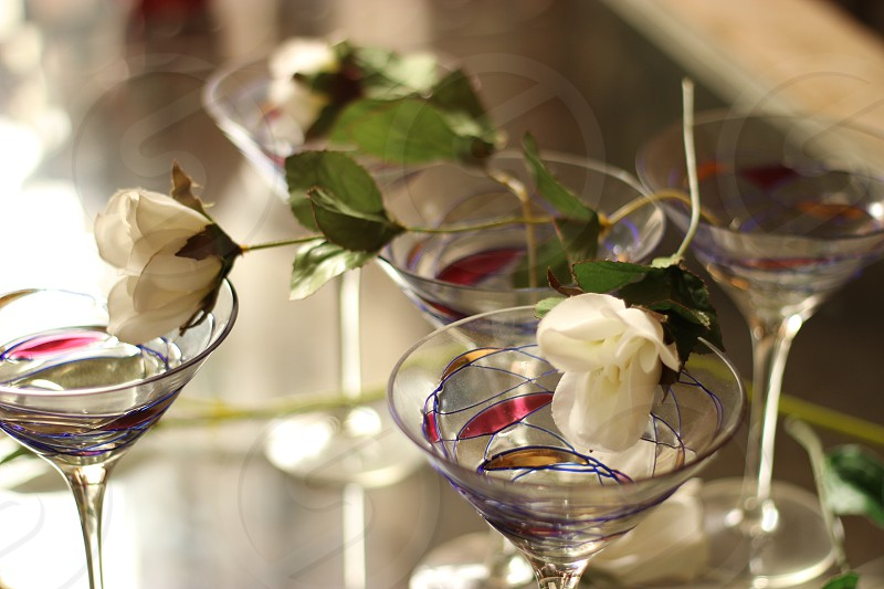 Plastic flowers in decorative glasses. photo