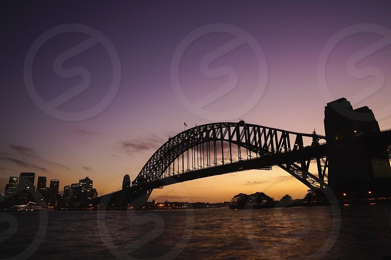 silhouette view of Sydney Harbour Bridge on colourful twilight sky. The Harbour Bridge is the world's widest long-span bridge. Australia:10/04/18 photo