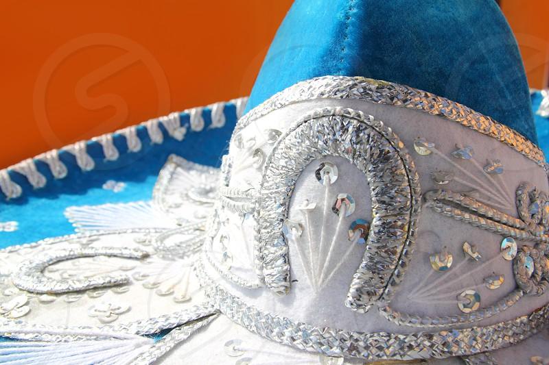 charro mariachi blue mexican hat detail over orange background Mexico photo