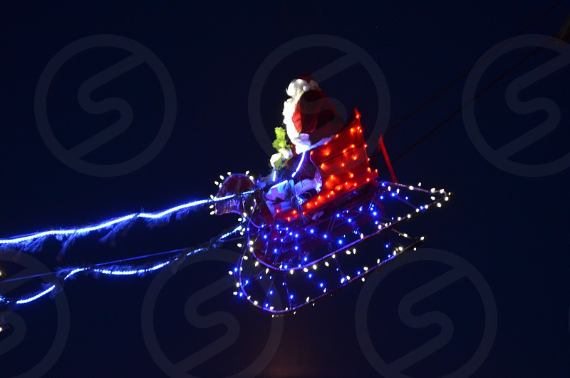 Santa flies over Main Street photo