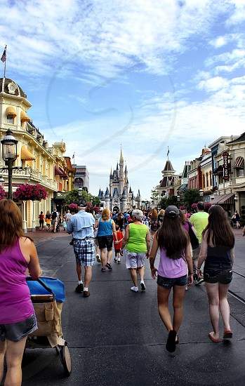 Disney world families family crowd destination castle site fun landmark iconic travel dream enjoyment orlando Florida vacation getaway children magic magical castle Cinderella cinderellas castle fairytale fairy tales wishes believe happy escape  photo
