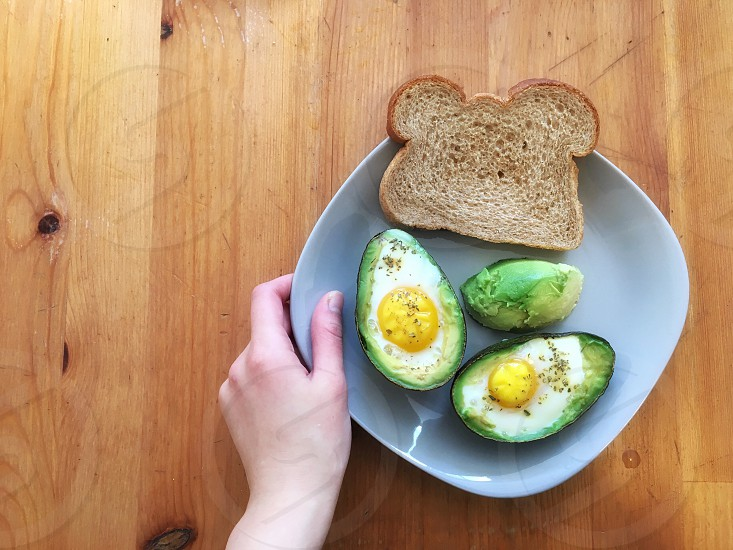 Avocado with eggs and toast   photo