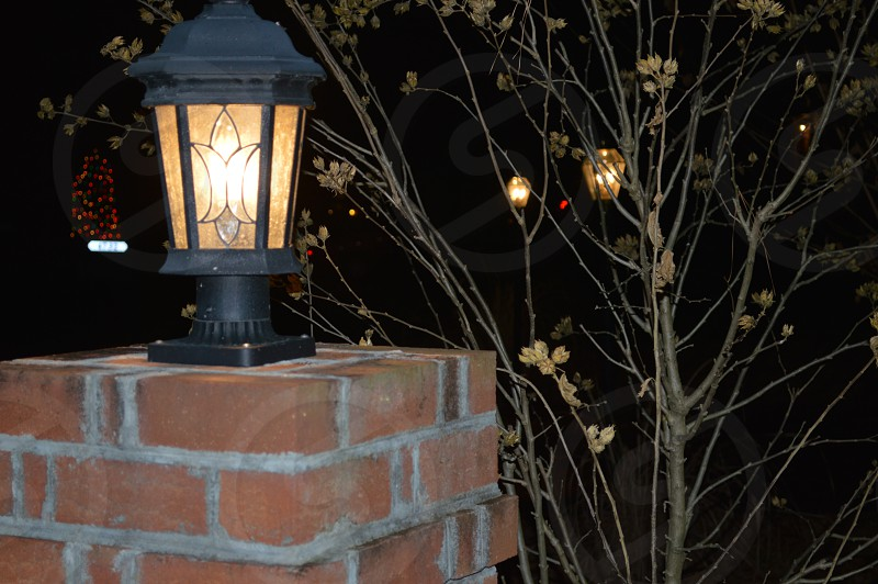 black outdoor lamp turned on photo